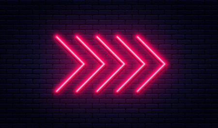 Neon arrow sign. Glowing neon arrow pointer on brick wall background. Retro signboard with bright neon tubes. Vector