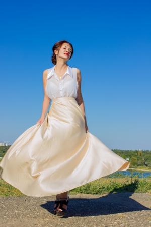 long skirt: Portrait of a beautiful brunette girl in a blouse and long skirt Stock Photo