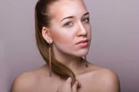 neatness: Studio beauty portrait of a beautiful young woman with makeup and hair brown Stock Photo