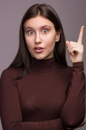 Studio emotional portrait of a beautiful young brunette woman with natural make-up  photo