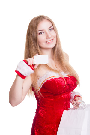 beautiful sexy girl wearing santa claus clothes with white paper bags and credit card in her hands photo