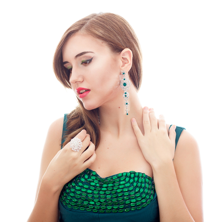Elegant Posh Woman with Diamond Earrings. Platinum Jewelry with green Diamonds Stock Photo