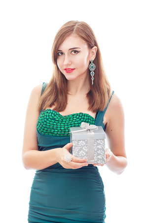 platinum hair: Elegant Posh Woman with Diamond Earrings And Ring. Platinum Jewelry with green And White Diamonds. Gift In Silver Box in Her Hands