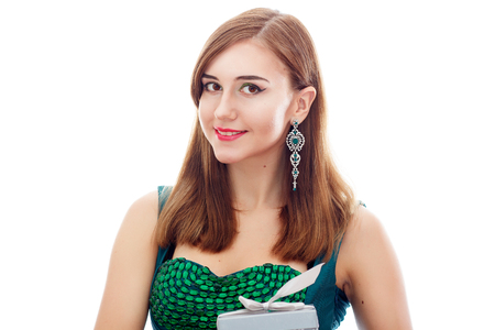 Elegant Posh Woman with Diamond Earrings And Ring. Platinum Jewelry with green And White Diamonds. Gift In Silver Box in Her Hands