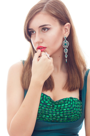 Elegant Posh Woman with Diamond Earrings And Ring. Platinum Jewelry with green And White Diamonds