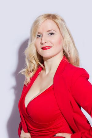 Beautiful, sexy, elegant blonde female model in red suit