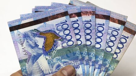 Inflation or devaluation in Kazakhstan.Issuance of mortgages,loans,credits.Paper money tenge.Bundle of money.Banknotes tenge.Wages of workers in Kazakhstan.Salary increases,pensions,social benefits.