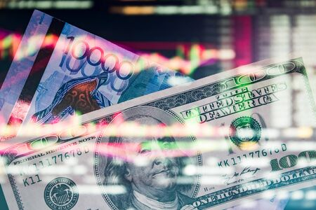 Tenge with dollar on the trading chart. Analysis of the currency pair tenge to dollar. Crisis. Depreciation. Play on the exchange with Kazakhstan tenge KZT, currency market, stock market. Foto de archivo
