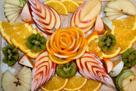 Vegan food fruit salad of kiwi, orange, citrus and Apple. Vitamin Breakfast and fresh fruit salad for a healthy lifestyle.