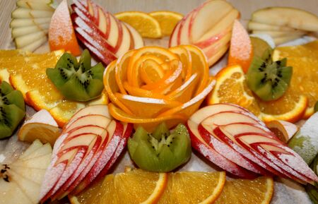 Vegetarian fruit salad of kiwi, orange, citrus and Apple. Vitamin Breakfast and fresh fruit salad for a healthy lifestyle.