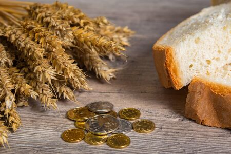 Kazakhstan tenge on the table with wheat ears and bread. Bread in Kazakhstan and Kazakhstan wheat. 写真素材
