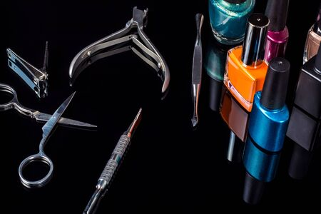 Manicure and pedicure tools on black background, isolated. Equipment for beauty shop, cosmetic salon or beauty parlour. Manicure tools in the beauty salon. Equipment for manicure or pedicure salon. Foto de archivo