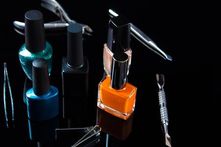 Manicure and pedicure tools on black background, isolated. Equipment for beauty shop, cosmetic salon or beauty parlour. Manicure tools in the beauty salon. Equipment for manicure or pedicure salon. Banque d'images