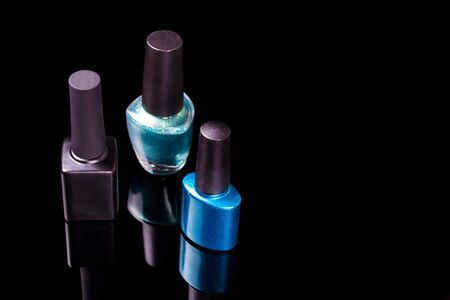 gel Polish for manicure on a white black background isolated, with space. Scattered nail Polish in the beauty salon. The choice of color nail Polish for manicure or pedicure.