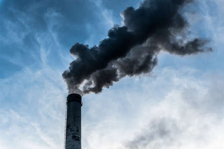 Smoking factory chimneys with co2 emissions.Environmental problem of environmental and air pollution.Climate change, ecology, global warming.The sky is smoky with toxic substances.Soot from factories