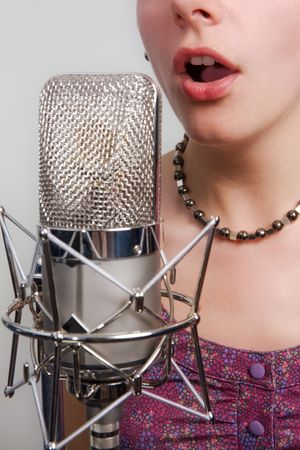 Girl with vintage microphone photo