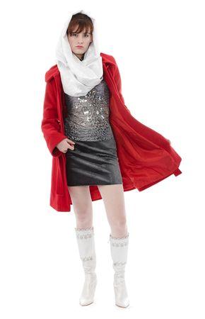 Woman in red coat is walking