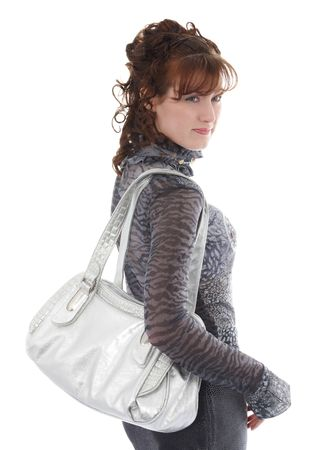 studio shot of posing woman with bag, isolated over white
