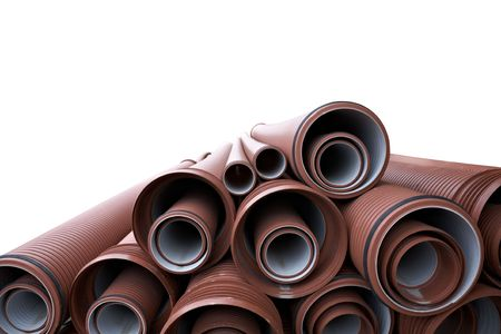 close up of a stack of pipes isolated in white