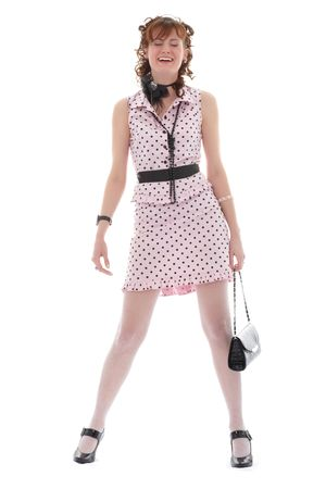A young fashionable young woman dressed in a trendy, glamorous outfit.  White background. photo