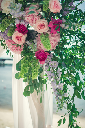 The wedding arc is decorated with flowers at the wedding ceremony Stock Photo