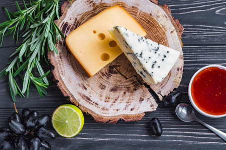cheeses on wood are chopped deliciously and nutritionally