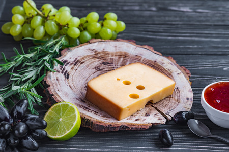 tabla de quesos: cheeses on wood are chopped deliciously and nutritionally