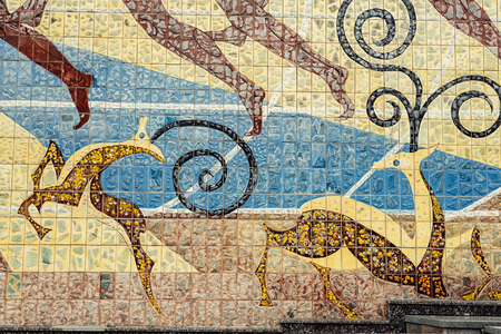 wall with old ornament lined with ceramic tiles ussr, beasts, deer, nature, wild on the wall, escape
