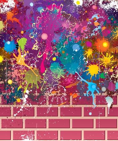 Splatter colors on brick wall.