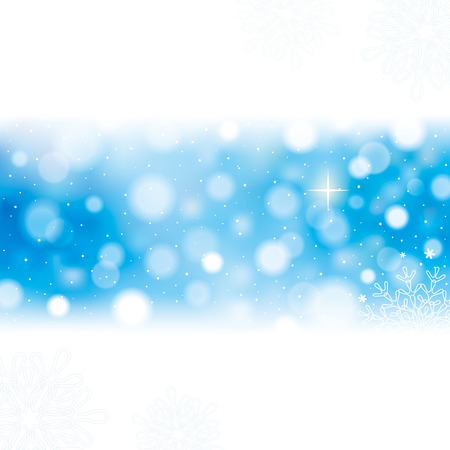 Winter holidays seasonal abstract blur blue background.