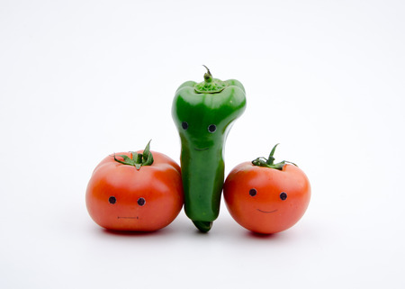 personification: Personification of tomatoes and bell peppers Stock Photo