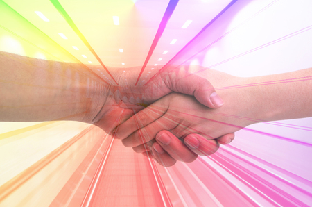 a courtesy: Men and women shake hands