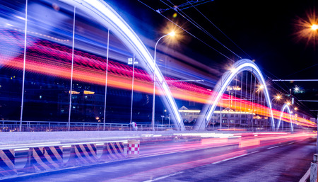 Moving cars with fast blurred trail of headlights. Editorial