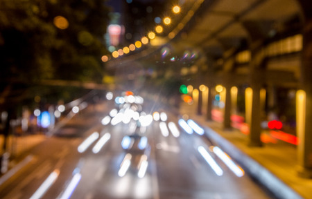 irradiation: Moving cars with fast blurred trail of headlights. Stock Photo