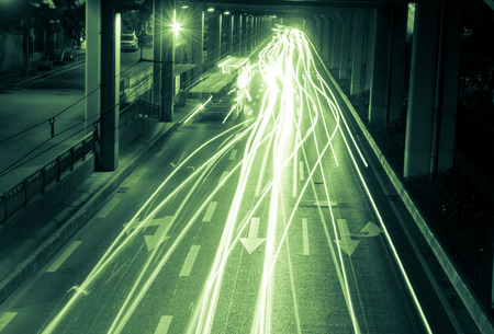 headlights: Moving cars with fast blurred trail of headlights. Stock Photo