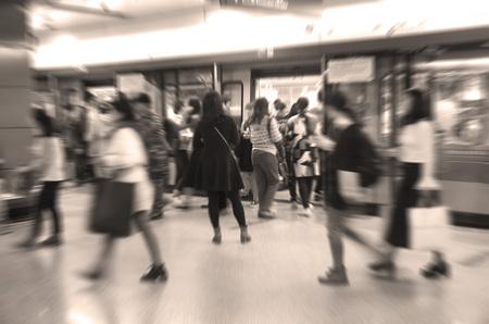 People entering a train Фото со стока