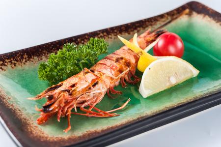 arugola: Japanese grilled prawn, kaiseki Stock Photo