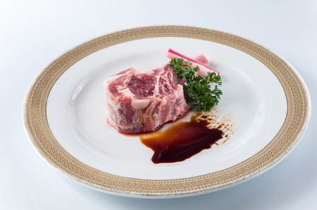 lamb chop: raw fresh lamb chop on white background