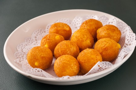 Khanom kai nok krata or deep-fried sweet potato balls Stock fotó