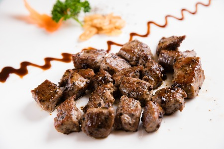 sizzling: Beef Steak Served on a Sizzling Iron Plate