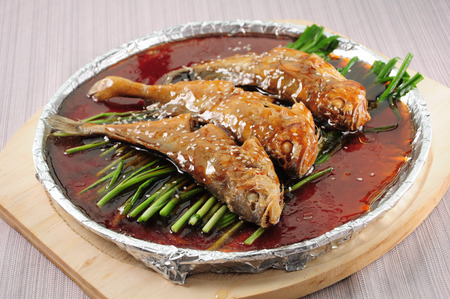 sizzling: Chinese cuisine--Yellow Croaker on a Sizzling Iron Plate