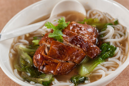 peking: Popular Asian Cuisine - Slices of Roasted Peking Duck with Rice Noodles Soup Bowl