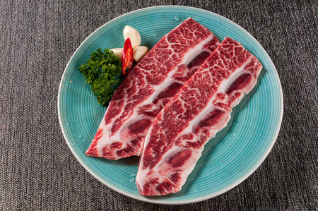 raw beef rib on the green plate
