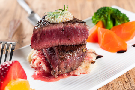 medium roast rib-eye steak on white plate