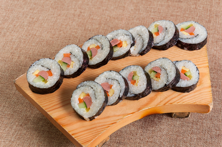 Sushi in a wooden dish
