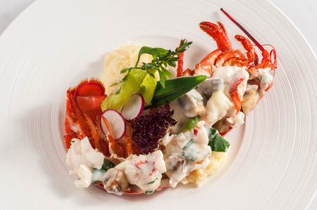 Lobster salad on the white plate