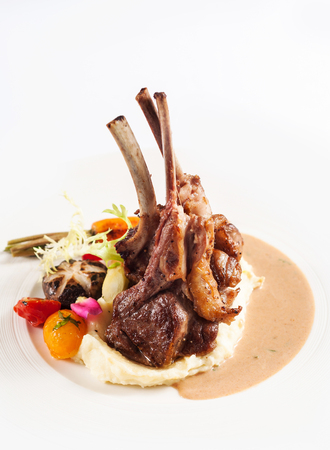 grilled lamb chops with vegetable salad and mashed potato