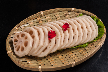 sliced lotus root on bamboo basket Stock fotó