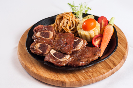 grilled beef rib with vegetables and noodles