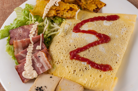 Omelet with salad